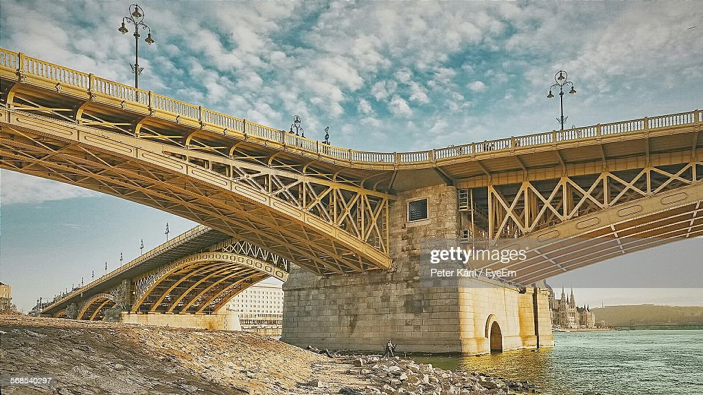 Low Angle View Of Arch Bridge Over River Against Sky : Stock Photo