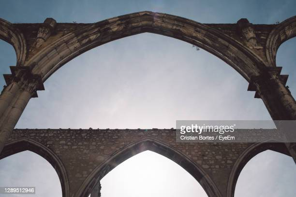 low angle view of arch bridge - bortes stock pictures, royalty-free photos & images