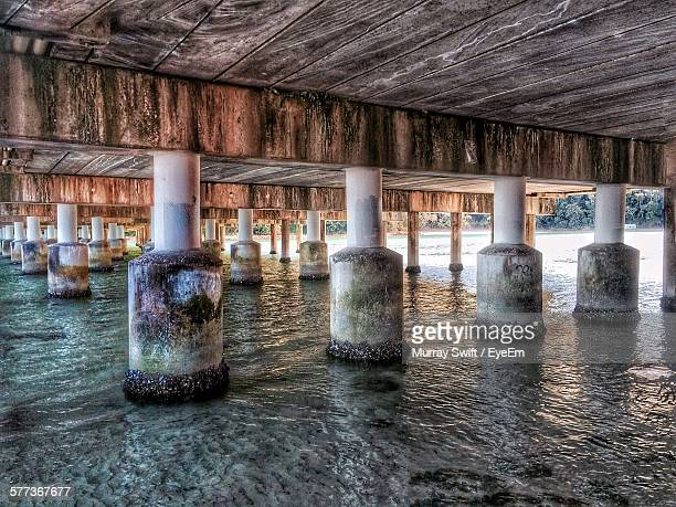 low angle view of architectural columns under bridge over river - swift river fotografías e imágenes de stock
