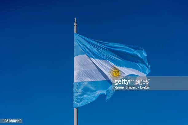 low angle view of argentina flag against clear blue sky - argentinas flagga bildbanksfoton och bilder