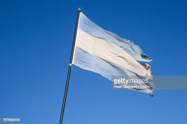 Low Angle View Of Argentina Flag Against Clear Blue Sky