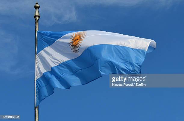 low angle view of argentinian flag against blue sky - argentinas flagga bildbanksfoton och bilder