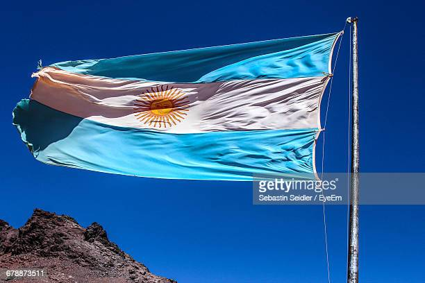Low Angle View Of Argentinian Flag Against Clear Blue Sky