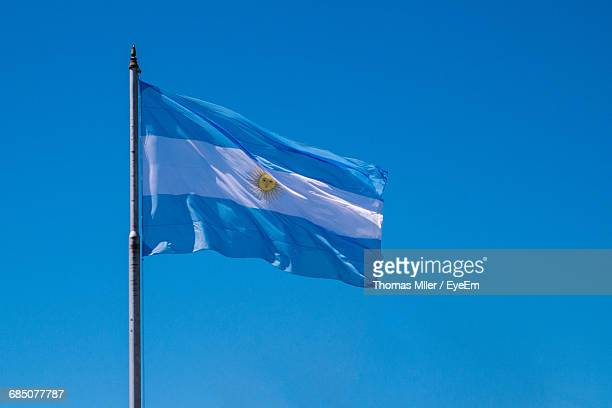 low angle view of argentinian flag waving against clear blue sky - argentinas flagga bildbanksfoton och bilder