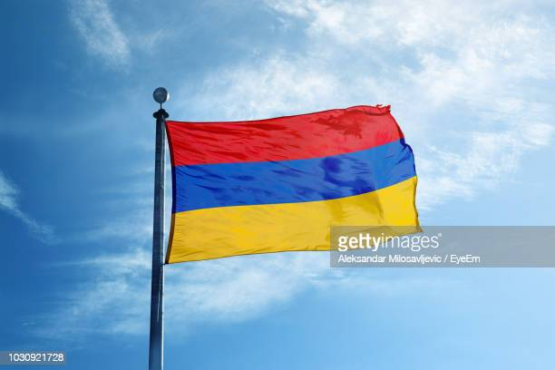 low angle view of armenian flag against blue sky - armenian flag stock pictures, royalty-free photos & images