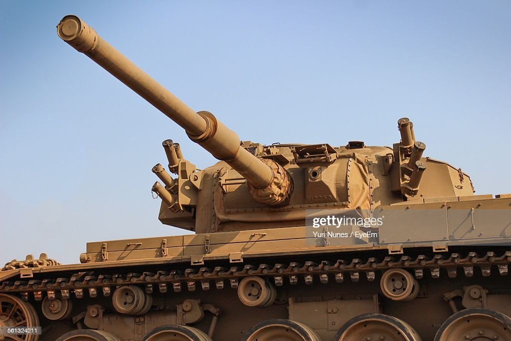 Low Angle View Of Armored Tank Against Clear Sky : Stock Photo