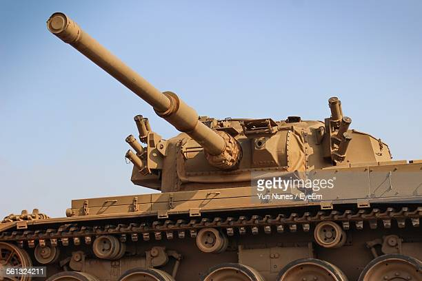 low angle view of armored tank against clear sky - armored tank stock photos and pictures