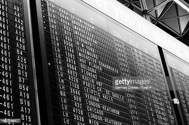 low angle view of arrival departure board at airport - frankfurt international airport stock pictures, royalty-free photos & images