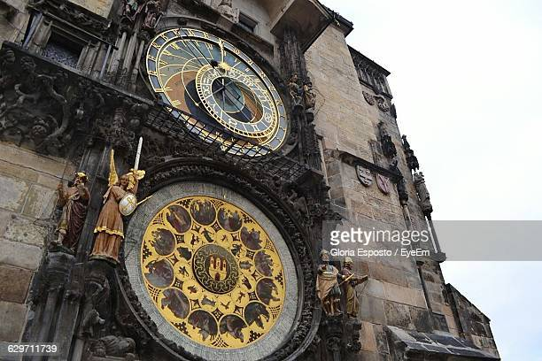 low angle view of astronomical clock on tower - astronomical clock prague stock pictures, royalty-free photos & images
