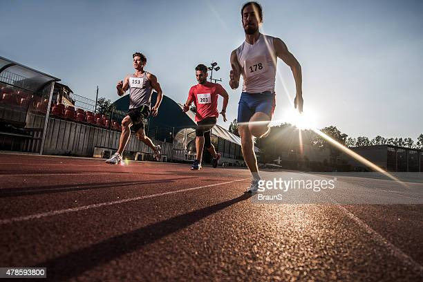 Low angle view of athletes having a sports race.