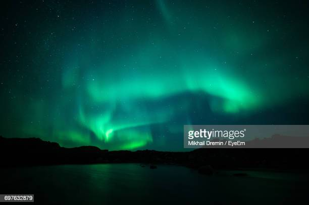 Low Angle View Of Aurora Borealis Over Lake