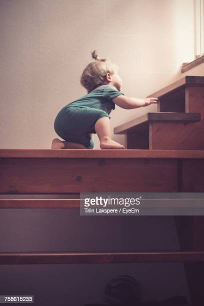 Low Angle View Of Baby Boy On Stairs
