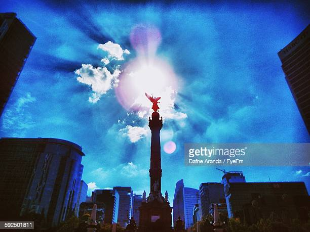 Low Angle View Of Back Lit El Angel In City