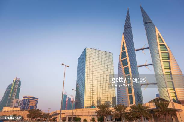 low angle view of bahrain world trade center in manama, bahrain - bahrain stock pictures, royalty-free photos & images