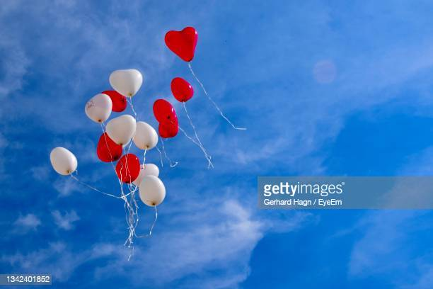 low angle view of balloons against sky - gerhard hagn stock-fotos und bilder
