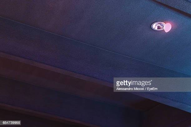low angle view of balloons below light fixture on ceiling - alessandro miccoli stockfoto's en -beelden