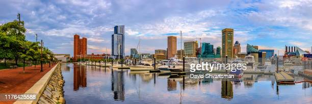 low angle view of baltimore harbor in the early morning - baltimore, maryland, usa, september 2019 - メリーランド州 ボルチモア ストックフォトと画像