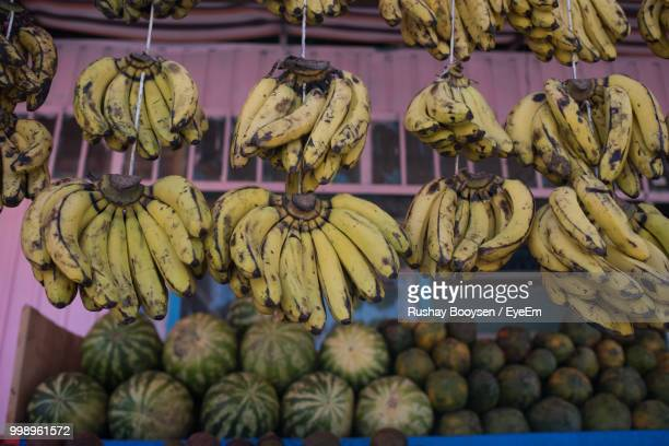 Low Angle View Of Bananas Hanging At Market