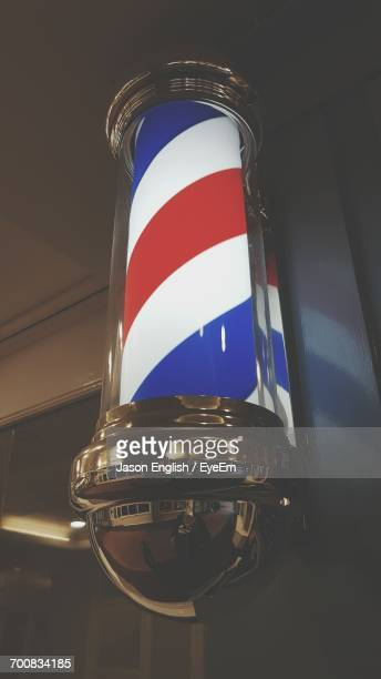 low angle view of barber pole - barber pole stock photos and pictures