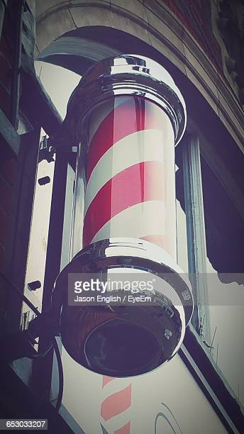 Low Angle View Of Barber Shop Pole