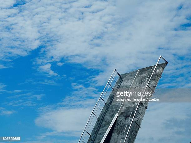 low angle view of bascule bridge against cloudy sky - oresund region stock photos and pictures