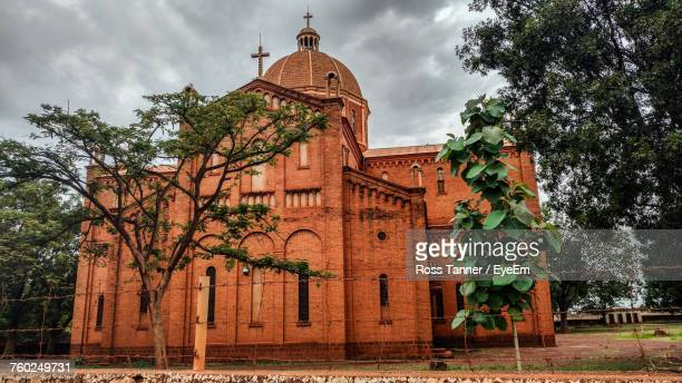 low angle view of basilica against cloudy sky - south sudan stock pictures, royalty-free photos & images