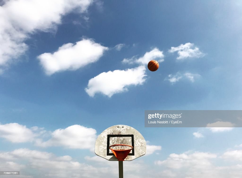 Low Angle View Of Basketball Ball Against Sky : Stock Photo