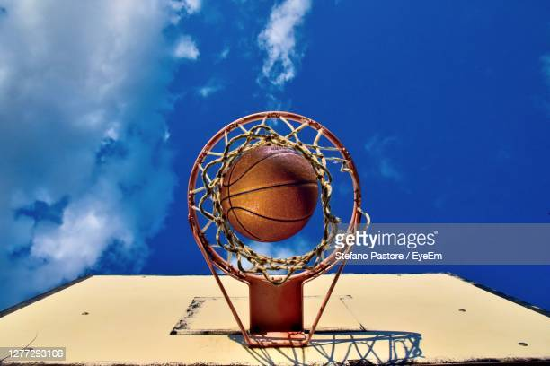 low angle view of basketball hoop against sky - treviso italy stock pictures, royalty-free photos & images