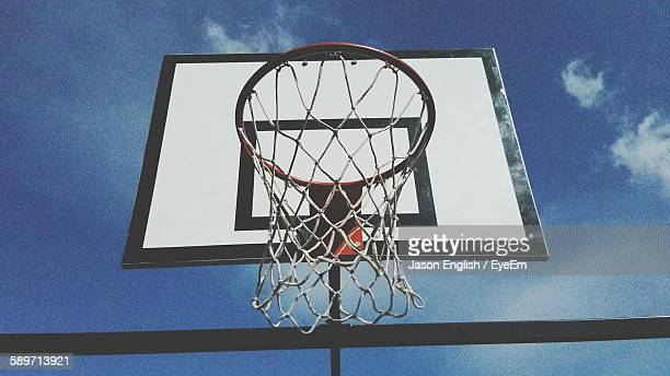 low angle view of basketball hoop against sky - basketball hoop stock pictures, royalty-free photos & images