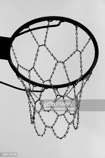 low angle view of basketball hoop against sky - albrecht schlotter stock photos and pictures