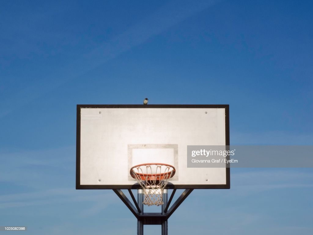 Low Angle View Of Basketball Hoop Against Wall : Stock Photo