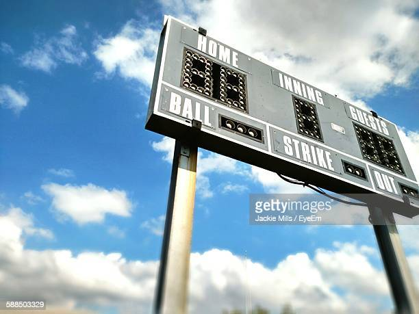 Low Angle View Of Basketball Scoreboard Against Cloudy Sky