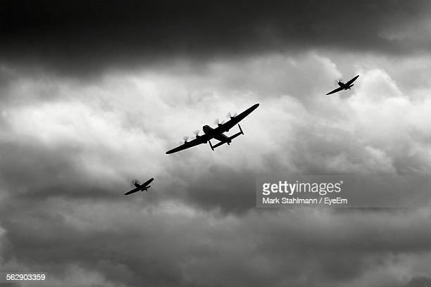 low angle view of battle of britain memorial flight over bournemouth - world war ii stock pictures, royalty-free photos & images