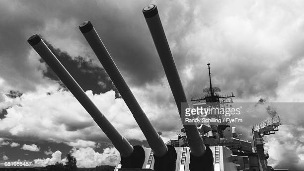 Low Angle View Of Battleship Against Cloudy Sky