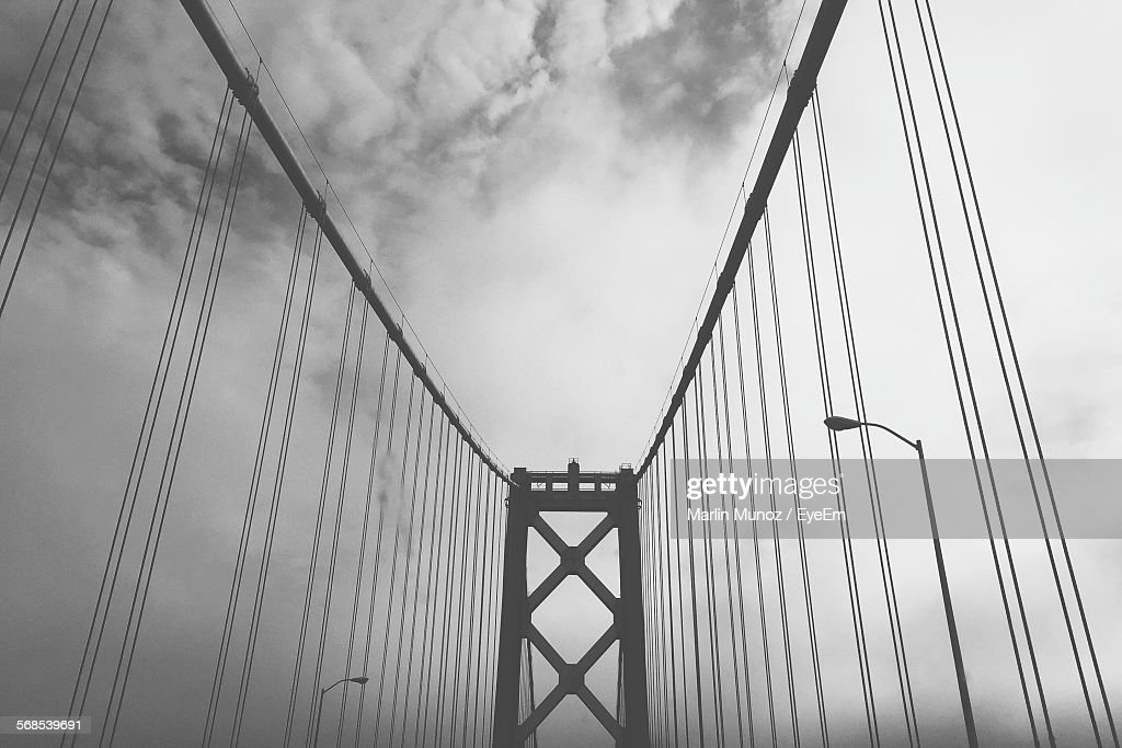 Low Angle View Of Bay Bridge Against Cloudy Sky : Stock Photo