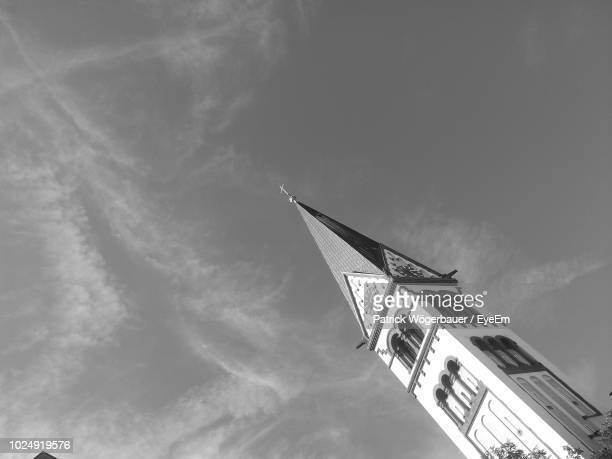 low angle view of bell tower against sky - spire stock pictures, royalty-free photos & images
