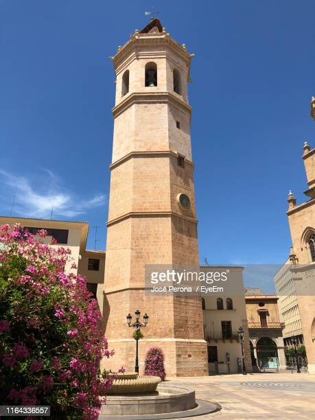 low angle view of bell tower against sky - castellon de la plana stock pictures, royalty-free photos & images