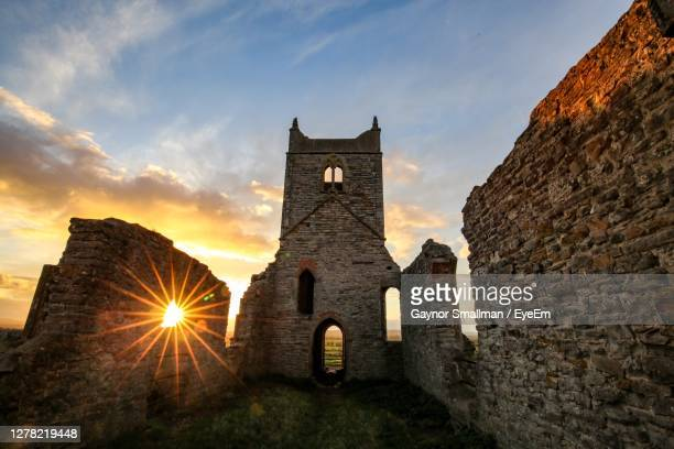 low angle view of bell tower at sunset - taunton somerset stock pictures, royalty-free photos & images