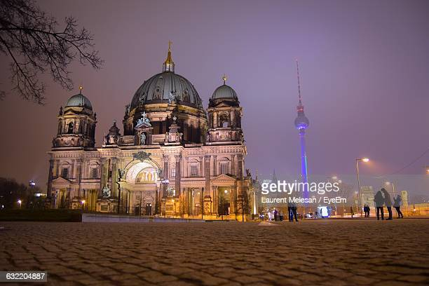 Low Angle View Of Berlin Cathedral And Fernsehturm At Night
