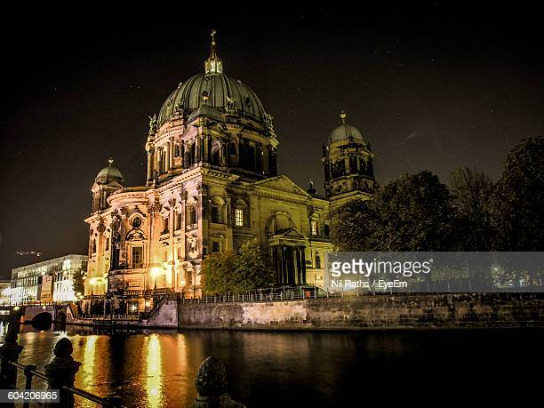 Low Angle View Of Berlin Cathedral By Lake At Night