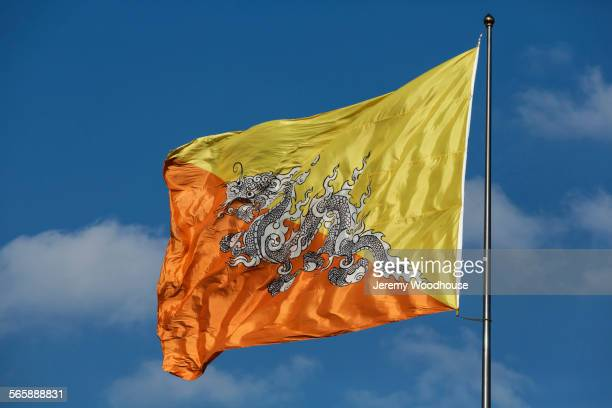 Low angle view of Bhutan flag in blue sky