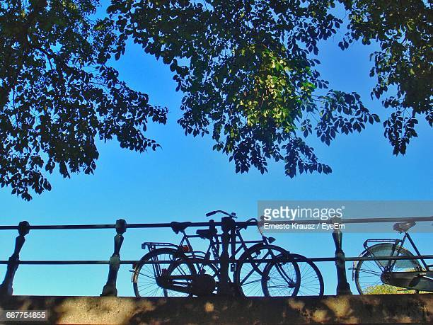low angle view of bicycles footbridge against clear blue sky - krausz stock-fotos und bilder