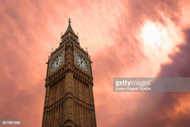 low angle view of big ben against cloudy sky - clock tower stock pictures, royalty-free photos & images