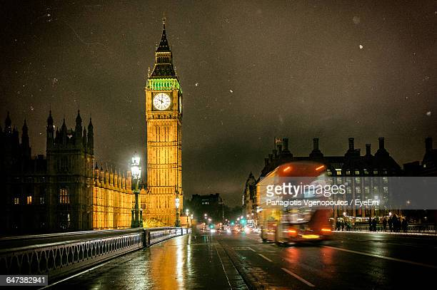 low angle view of big ben at night - vgenopoulos stock pictures, royalty-free photos & images