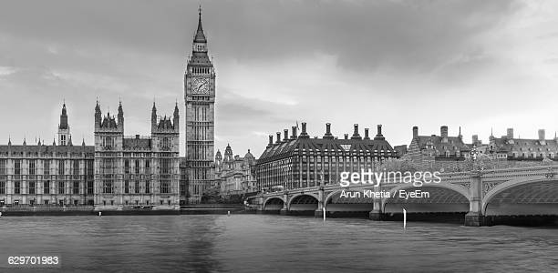 Low Angle View Of Big Ben By Thames River Against Sky
