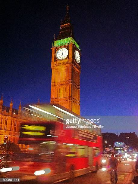 Low Angle View Of Big Ben In Front Of Bus At Dusk