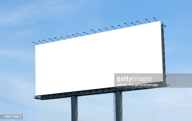 low angle view of billboard against clear blue sky - 道路 stock pictures, royalty-free photos & images