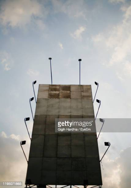 low angle view of billboard against sky - vertical stock pictures, royalty-free photos & images