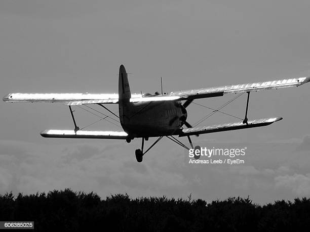 Low Angle View Of Biplane Flying In Sky