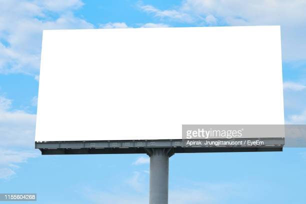 low angle view of black billboard against sky - billboard stock pictures, royalty-free photos & images